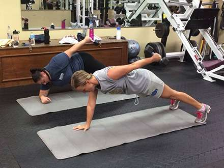 Client Exercising with Personal Trainer